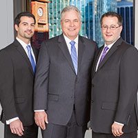 Group portrait of attorneys at Trapp & Geller