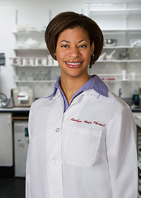 Studio headshot of Darilyn with laboratory background